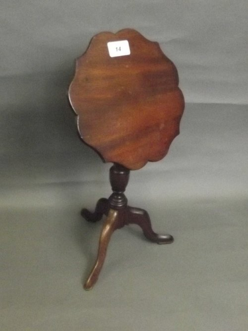 An Edwardian mahogany miniature tilt top tripod table