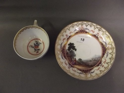 An C18th Meissen cabinet cup and saucer painted with