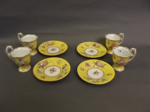 A set of 4 C19th Dresden yellow ground cups and saucers