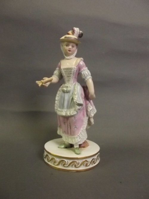 An early C19th Meissen porcelain figure of a maiden