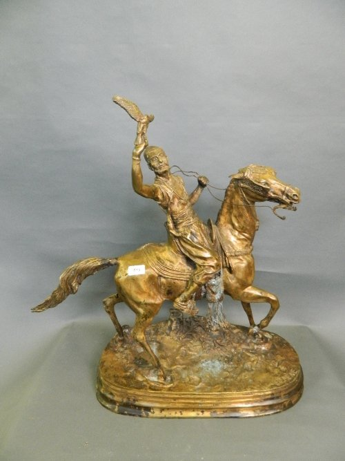 A large gilt bronze model of an Arab falconer on