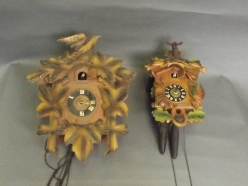 Two carved wood cuckoo clocks, largest 15'' high