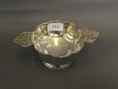A Hallmarked silver C19th twin handled quaiche with pie