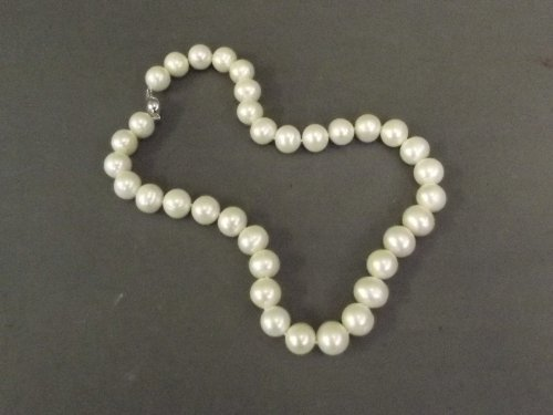 A large beaded natural pearl necklace, 16'' long