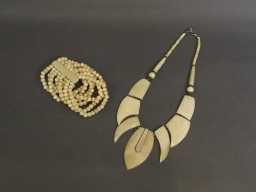 An African bone necklace and beaded bracelet, 17'' long