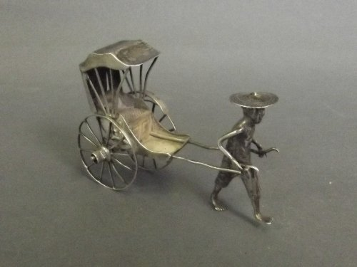 A Chinese white metal sculpture of a Rickshaw and drive