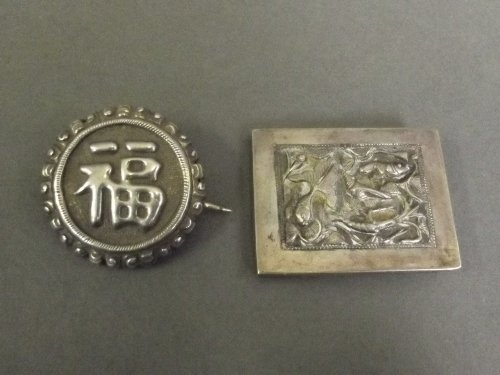 Two Chinese metal brooches, one decorated with shrimp a