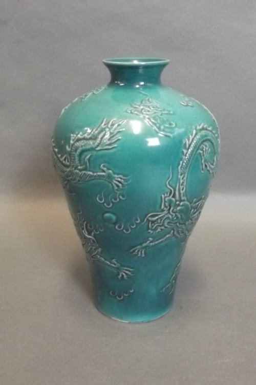 A Chinese turquoise vase with raised decoration to side