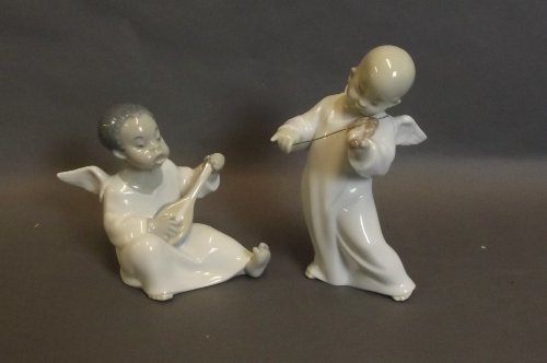 Two Lladro figures of winged boys playing musical instr