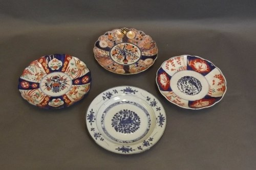 Four Oriental pottery plates to include 3 Imari plates