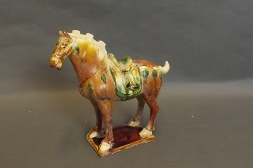 A Chinese Tang Dynasty style terracotta horse with a br