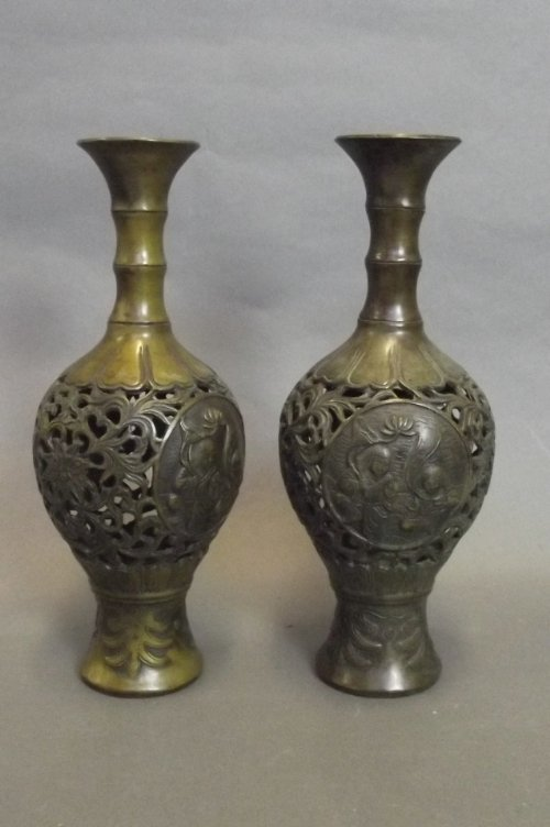 A pair of Japanese reticulated pierced bronze vases wit