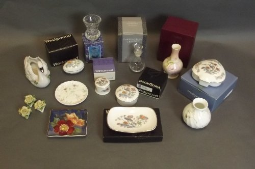 A quantity of boxed Wedgwood and Royal Worcester pots a