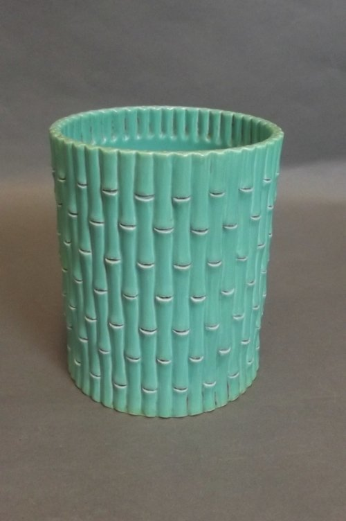 A Chinese green glazed brush pot in the form of bamboo,