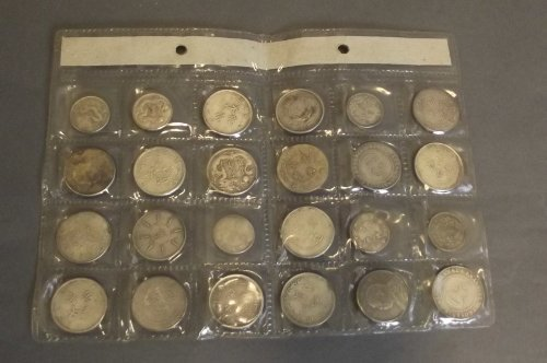 Twenty-four Chinese silvered metal coins