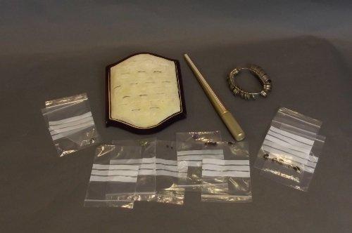A quantity of semi-precious stones, a ring display stan