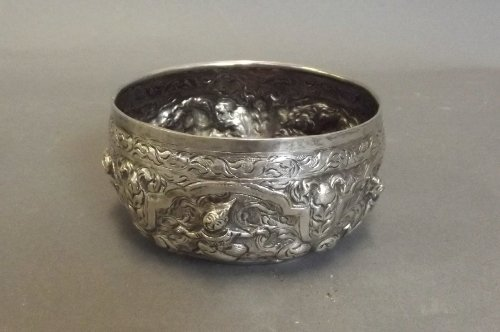 An Indian white metal bowl with repousse decoration of