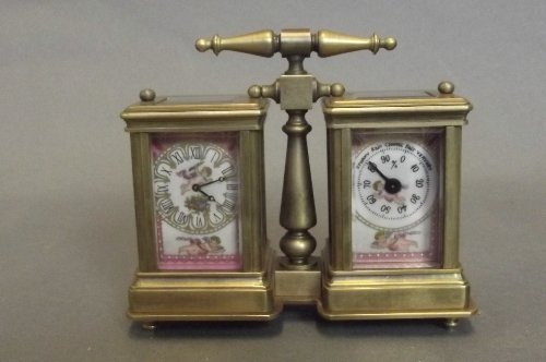 A brass and porcelain Sevres style double carriage cloc