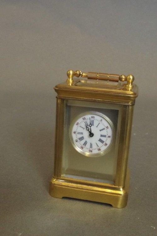 A miniature brass cased carriage clock, 1½'' x 1¼'', 2½