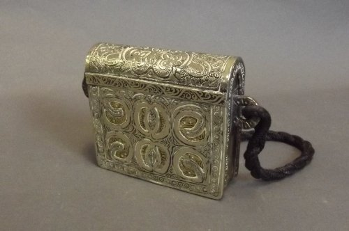 A low grade silver and brass Quran holder, 4½'' x 4¼''