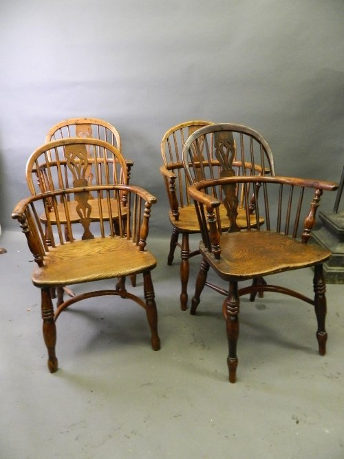 A set of 4 C18th yew and elm Windsor elbow chairs with