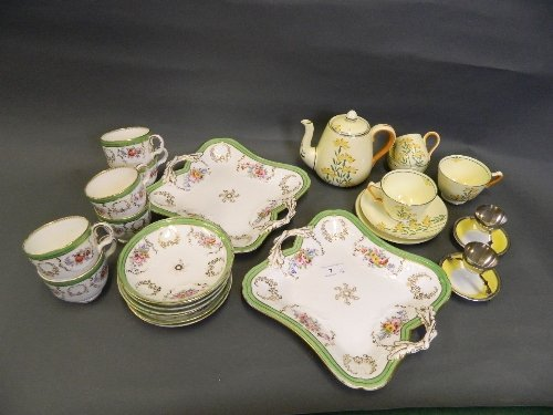 A C19th part service hand painted with flowers etc, and