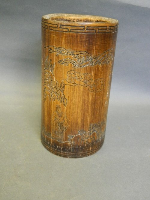 A Chinese bamboo brush pot with carved decoration of a
