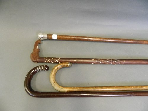 A Hallmarked silver topped walking stick, and 3 others