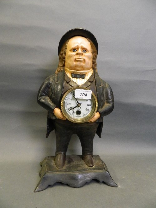 A painted cast iron automaton clock in the form of a
