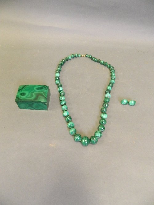 A malachite graduated bead necklace, a pair of