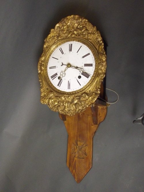 A C19th French repousse bracket clock with date and an