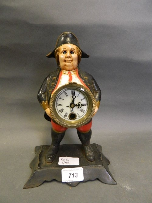 A painted iron automaton clock in the form of a