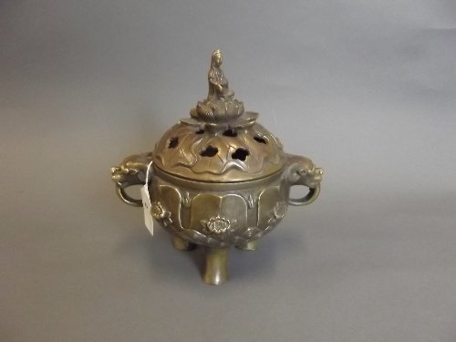 A Chinese bronze twin handled incense burner surmounted