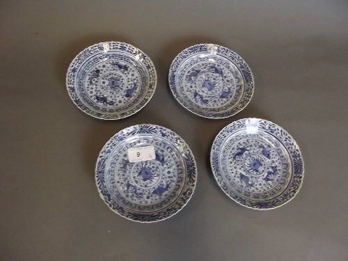 A set of 4 Chinese blue and white saucers painted with