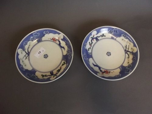 A pair of Japanese blue, white and red saucer dishes