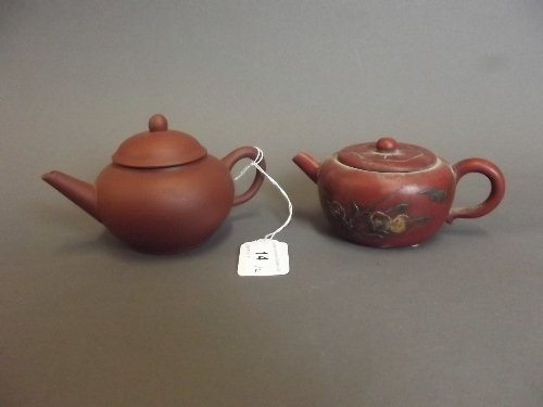 A Chinese Yixing pottery teapot, 3'' high, and another