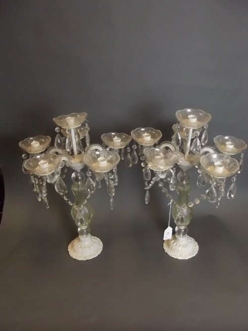 A pair of glass and metal 5 branch table candelabra,