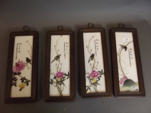 A set of 4 Chinese wood framed pottery wall panels,