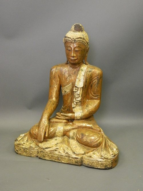 A large C19th Eastern gilt and painted wooden seated