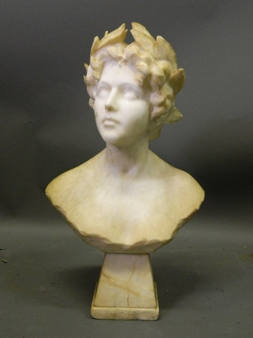 A C19th marble bust of a maiden with a laurel in her