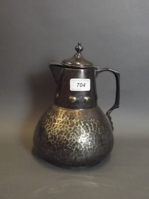 A C19th Arts & Crafts silver plated hot water jug, 9''