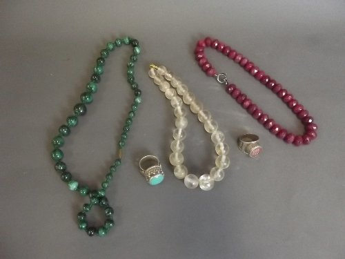 Two Islamic silver rings, and 3 stone necklaces