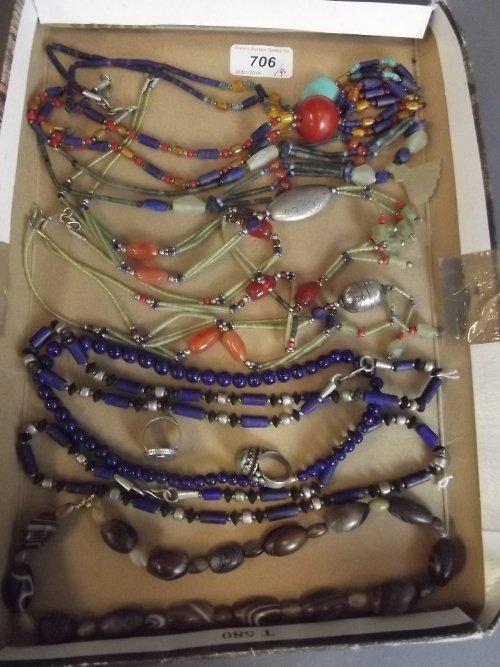 A quantity of Eastern silver and stone set necklaces,