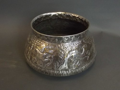 An Indian silver plated bowl with repousse decoration