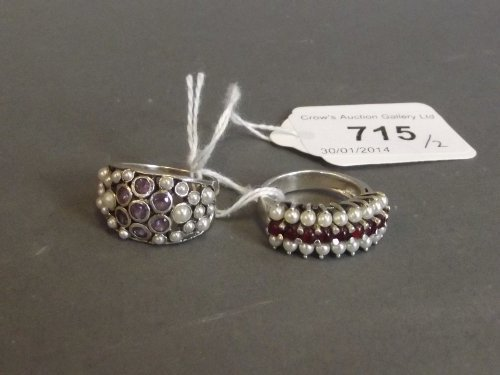 A 925 silver ring set with amethysts and seed pearls,