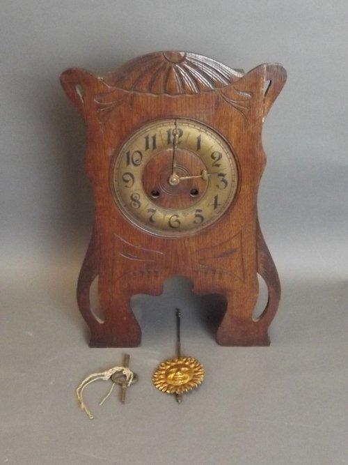 A French oak and brass Art Nouveau mantle clock, 11'' x