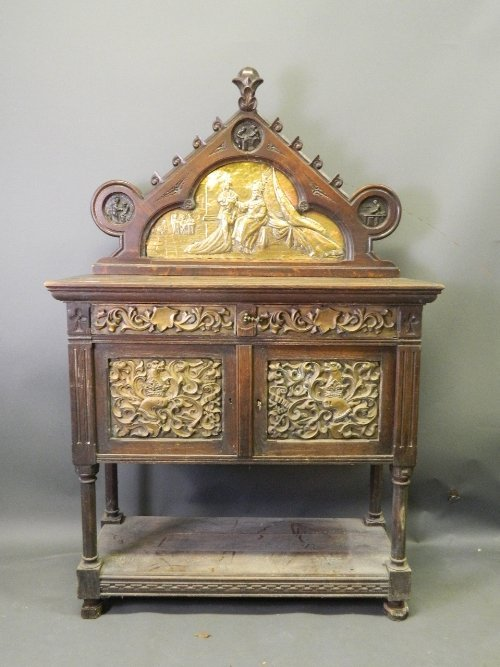 A good C19th oak and brass gothic revival side cabinet,