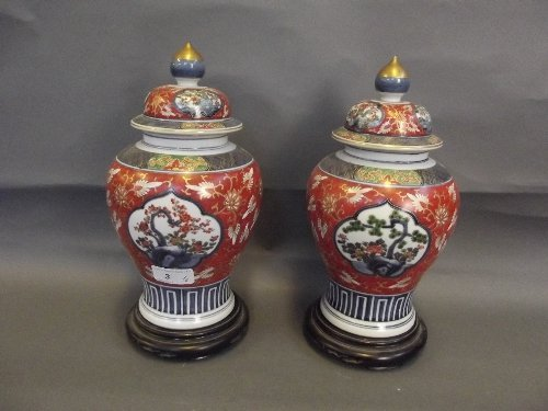 A pair of early C20th Japanese Imari vases and covers