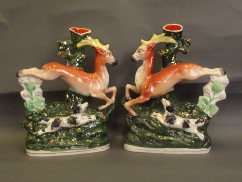 A pair of Staffordshire spill vases in the form of