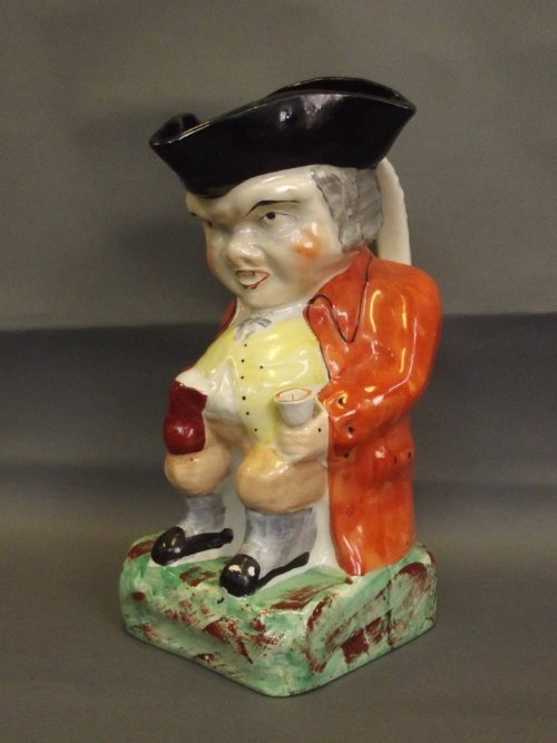 A Staffordshire William Kent Toby jug in the form of a
